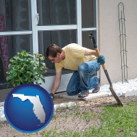 florida map icon and a landscape contractor working on a landscaping project