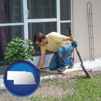 nebraska map icon and a landscape contractor working on a landscaping project