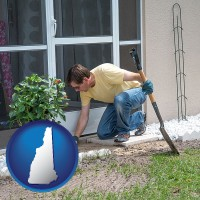 new-hampshire map icon and a landscape contractor working on a landscaping project