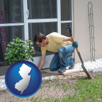 new-jersey map icon and a landscape contractor working on a landscaping project