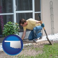 oklahoma map icon and a landscape contractor working on a landscaping project
