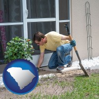 south-carolina map icon and a landscape contractor working on a landscaping project