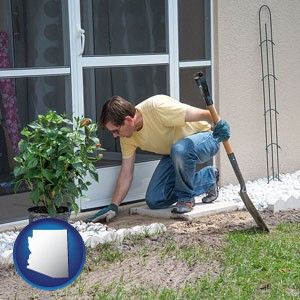 a landscape contractor working on a landscaping project - with Arizona icon