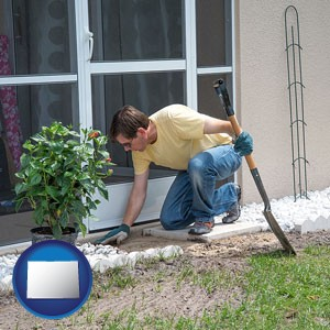 a landscape contractor working on a landscaping project - with Colorado icon
