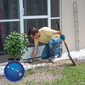 a landscape contractor working on a landscaping project - with Hawaii icon