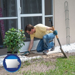 a landscape contractor working on a landscaping project - with Iowa icon