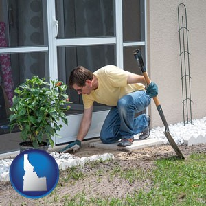 a landscape contractor working on a landscaping project - with Idaho icon
