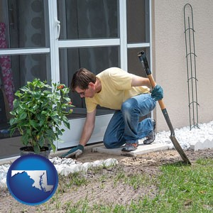 a landscape contractor working on a landscaping project - with Maryland icon
