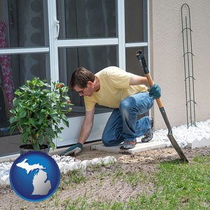 a landscape contractor working on a landscaping project - with Michigan icon