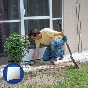 a landscape contractor working on a landscaping project - with New Mexico icon