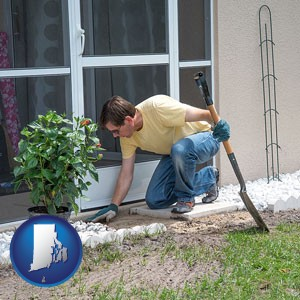 a landscape contractor working on a landscaping project - with Rhode Island icon