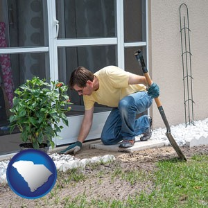 a landscape contractor working on a landscaping project - with South Carolina icon