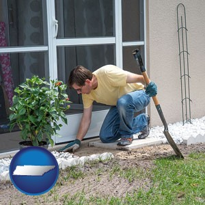 a landscape contractor working on a landscaping project - with Tennessee icon
