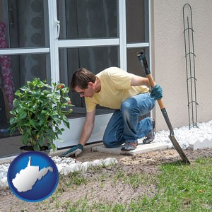 a landscape contractor working on a landscaping project - with West Virginia icon