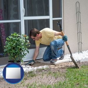 a landscape contractor working on a landscaping project - with Wyoming icon